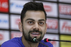 India's cricket player Virat Kohli smiles during a press conference ahead of the Asia Cup tournament in Dhaka, Bangladesh, Tuesday, Feb. 23, 2016. India will play with Bangladesh in the opening match of the five nations Twenty20 cricket event that begins Wednesday. (AP Photo/A.M. Ahad)